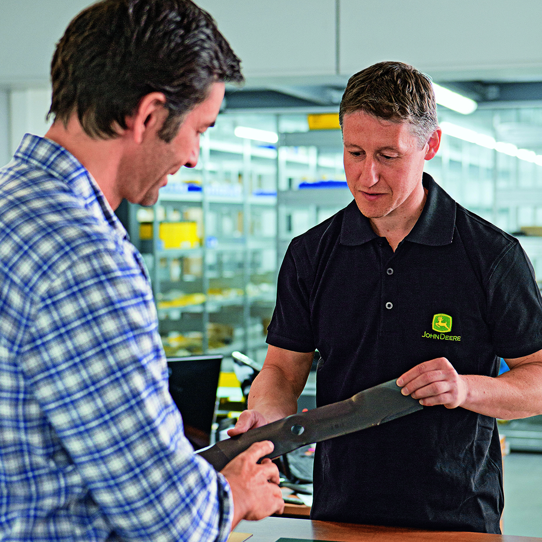 Parts consultant with customer